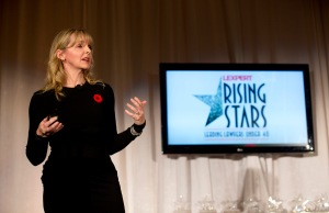 Kirstine Stewart, Managing Director of Twitter Canada and Former Vice-President of CBC English Services, giving the keynote speech next to the Rising Stars logo at the 2013 Rising Stars event.